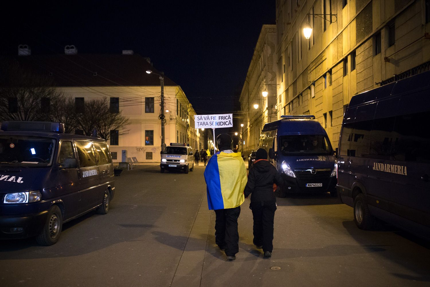 Image of two people going home from a protest in Timisoara, Romania
