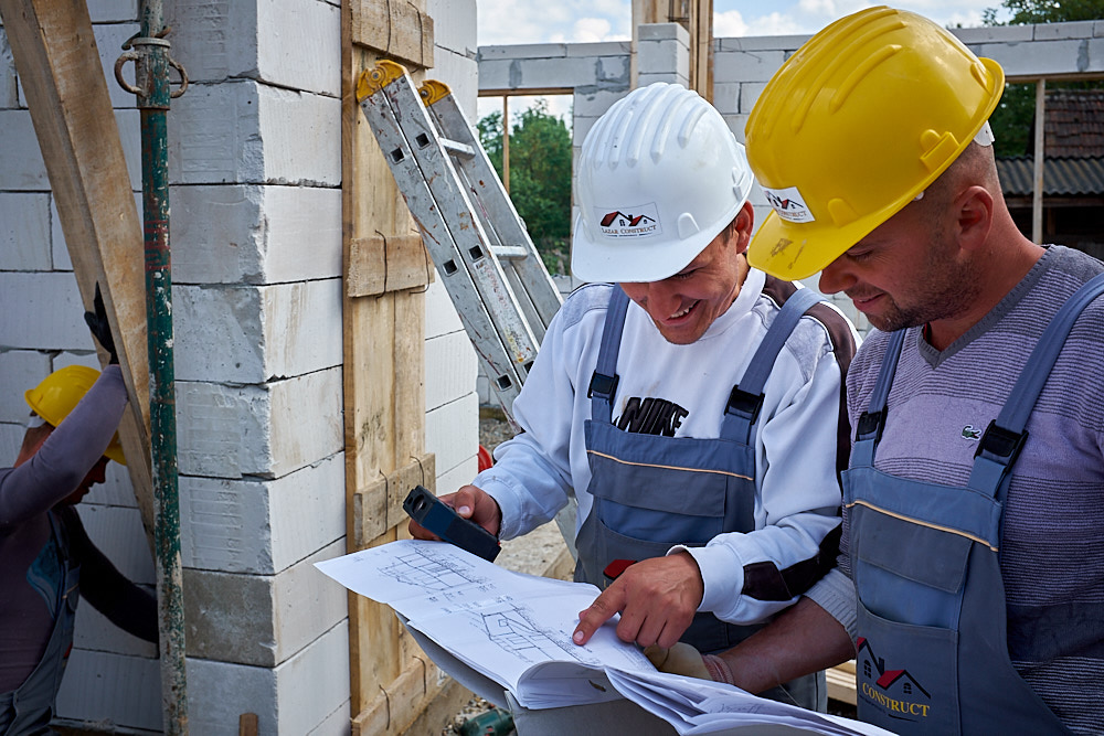 image of construction workers consulting a plan - commercial photography